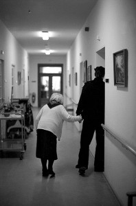 man walking woman in nursing home
